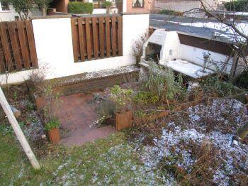 Grillecke im hinteren Teil des Gartens
