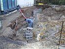 Handwerker bei Mauerarbeiten